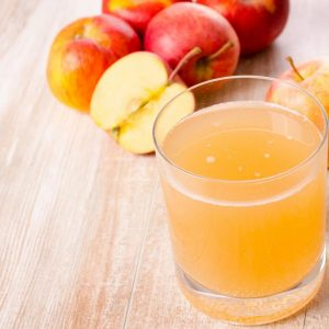Glass of organic apple juice on a kitchen table